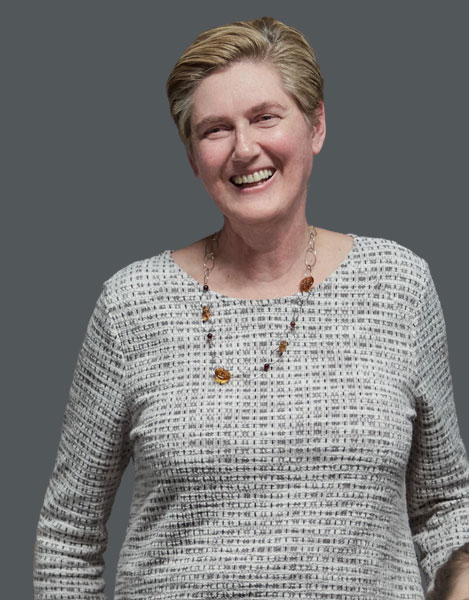 Darrell Farrow, career and parenting coach, candidly smiling and laughing towards the camera as she addresses an audience at an event in Vancouver